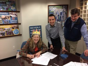 Martha Farmer, Justin D'Avita and Dave Harriss at lease signing